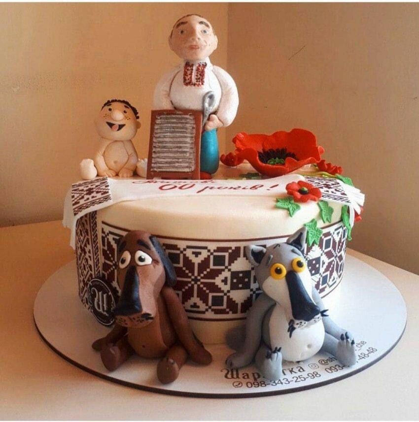 На фото торт украшенный мультипликационными героями, производитель кондитерских изделий на заказ Шарлотка.